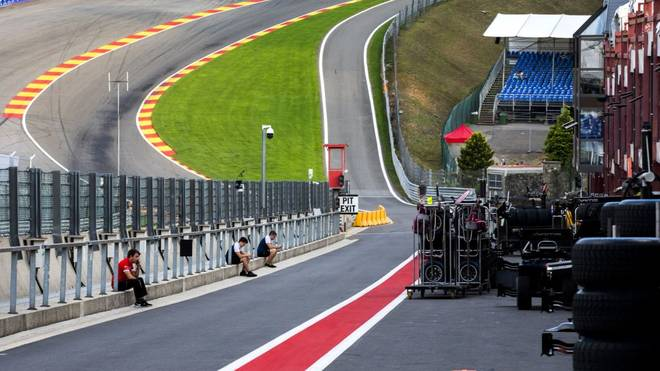 Mechanics sit in a deserted pit lane following a serious accident involving several drivers during a Formula 2 race at the Spa-Francorchamps circuit in Spa, Belgium, on August 31, 2019. - Motor racing prospect Anthoine Hubert was killed by a horrific high-speed crash just minutes into the Formula Two race held before this weekend's F1 Belgian Grand Prix, the FIA announced. Hubert, who was considered a serious talent by Renault's F1 set up, died aged 22 following a three-car pile-up also involving Juan Manuel Correa and Giuliano Alesi at the exit of the Raidillon corner, one of the fastest sections of the quick Spa-Francorchamps track. (Photo by Remko de Waal / ANP / AFP) / Netherlands OUT - Belgium OUT        (Photo credit should read REMKO DE WAAL/AFP/Getty Images)
