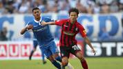 MAGDEBURG, GERMANY - AUGUST 10: Tarek Chahed (L) of Magdeburg and Woo-Yeong Jeong (R) of Freiburg compete for the ball during the DFB Cup first round match between 1. FC Magdeburg and SC Freiburg at MDCC Arena on August 10, 2019 in Magdeburg, Germany. (Photo by Ronny Hartmann/Bongarts/Getty Images)