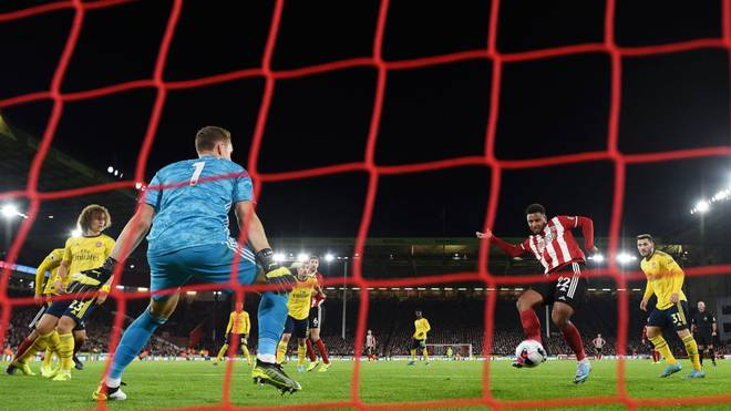 SHEFFIELD, ENGLAND - OCTOBER 21:   Lys Mousset of Sheffield United scores his sides 1st goal during the Premier League match between Sheffield United and Arsenal FC at Bramall Lane on October 21, 2019 in Sheffield, United Kingdom. (Photo by Michael Regan/Getty Images)