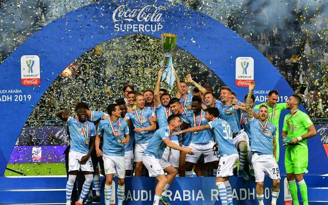 Lazio's players celebrate after winning the Supercoppa Italiana final football match between Juventus and Lazio at the King Saud University Stadium in the Saudi capital Riyadh on December 22, 2019. (Photo by GIUSEPPE CACACE / AFP) (Photo by GIUSEPPE CACACE/AFP via Getty Images)