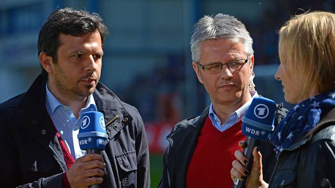 BIELEFELD, GERMANY - MAY 02: Sports directors Samir Arabi (L) of Bielefeld and Ralf Heskamp (C) of Kiel are being interviewed during the Third League match between Arminia Bielefeld and Holstein Kiel at Schueco Arena on May 2, 2015 in Bielefeld, Germany.  (Photo by Thomas Starke/Bongarts/Getty Images)