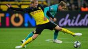 Dortmund's German forward Julian Brandt (L) and Barcelona's Dutch midfielder Frenkie De Jong vie for the ball during the UEFA Champions League Group F football match Borussia Dortmund v FC Barcelona in Dortmund, western Germany, on September 17, 2019. (Photo by SASCHA SCHUERMANN / AFP)        (Photo credit should read SASCHA SCHUERMANN/AFP via Getty Images)