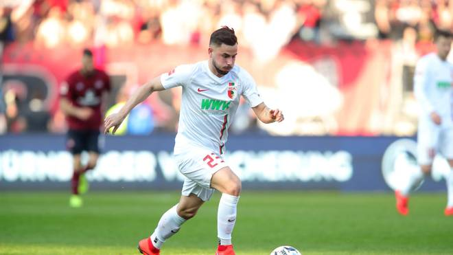 NUREMBERG, GERMANY - MARCH 30: Marco Richter of Augsburg runs with the ball during the Bundesliga match between 1. FC Nuernberg and FC Augsburg at Max-Morlock-Stadion on March 30, 2019 in Nuremberg, Germany. (Photo by Alexander Hassenstein/Bongarts/Getty Images)