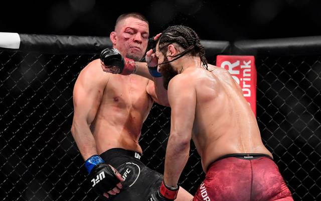 "NEW YORK, NEW YORK - NOVEMBER 02: Nate Diaz of the United States (L) fights against Jorge Masvidal of the United States in the Welterweight ""BMF"" championship bout during UFC 244 at Madison Square Garden on November 02, 2019 in New York City. (Photo by Steven Ryan/Getty Images)"
