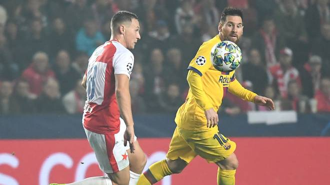 Slavia's Czech defender Jan Boril (L) and Barcelona's Argentinian forward Lionel Messi vie for the ball during the UEFA Champions League football match between SK Slavia Prague and FC Barcelona in Prague, Czech Republic on October 23, 2019. (Photo by JOE KLAMAR / AFP) (Photo by JOE KLAMAR/AFP via Getty Images)