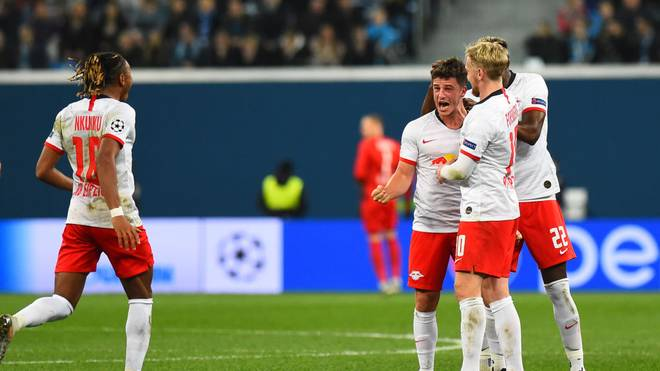 Leipzig's German midfielder Diego Demme celebrates with teammates after scoring a goal during the UEFA Champions League group G football match between FC Zenit and RB Leipzig at the Gazprom Arena in Saint Petersburg on November 5, 2019. (Photo by Olga MALTSEVA / AFP) (Photo by OLGA MALTSEVA/AFP via Getty Images)