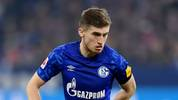 GELSENKIRCHEN, GERMANY - FEBRUARY 22: Jonjoe Kenny of Schalke controls the ball during the Bundesliga match between FC Schalke 04 and RB Leipzig at Veltins-Arena on February 22, 2020 in Gelsenkirchen, Germany. (Photo by Frederic Scheidemann/Bongarts/Getty Images)