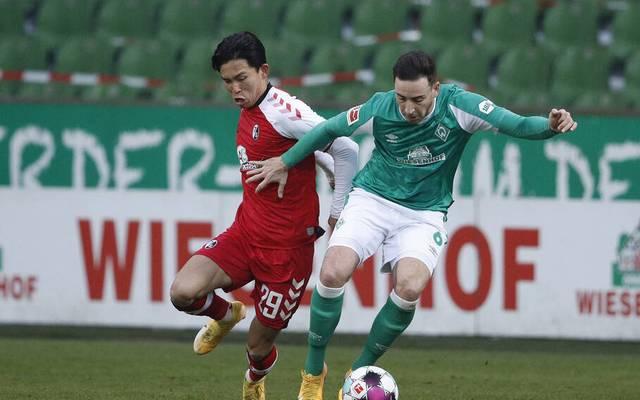 Werder Bremen (grün) und der SC Freiburg trennten sich leistungsgerecht Unentschieden
