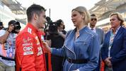 Ferrari's Monegasque driver Charles Leclerc (L) greets Princess Charlene of Monaco at the Yas Marina Circuit in Abu Dhabi, ahead of the final race of the season, on December 1, 2019. (Photo by ANDREJ ISAKOVIC / AFP) (Photo by ANDREJ ISAKOVIC/AFP via Getty Images)