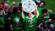 WOLFSBURG, GERMANY - MAY 23:  Makoto Hasebe of Wolfsburg celebrates the German Championship with the trophy after his Bundesliga match between VfL Wolfsburg and SV Werder Bremen at the Volkswagen Arena on May 23, 2009 in Wolfsburg, Germany. Wolfsburg won its first German Championship ever. (Photo by Vladimir Rys/Bongarts/Getty Images)