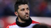 MADRID, SPAIN - JANUARY 11:  David Villa of Club Atletico de Madrid looks on prior to the start of the La Liga match between Club Atletico de Madrid and FC Barcelona at Vicente Calderon Stadium on January 11, 2014 in Madrid, Spain.  (Photo by Denis Doyle/Getty Images)