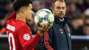 (FILES) In this file photo taken on December 11, 2019 Bayern Munich's German interim head coach Hans-Dieter Flick (R) watches Bayern Munich's Brazilian midfielder Philippe Coutinho preparing for a throw in during the UEFA Champions League Group B football match between Bayern Munich v Tottenham FC  in Munich, southern Germany. - Bayern Munich head coach Hansi Flick said he is willing to grant Philippe Coutinho time to rediscover his best form after finding himself relegated to the bench behind Thomas Mueller in recent weeks. (Photo by Odd ANDERSEN / AFP) / ALTERNATIVE CROP (Photo by ODD ANDERSEN/AFP via Getty Images)