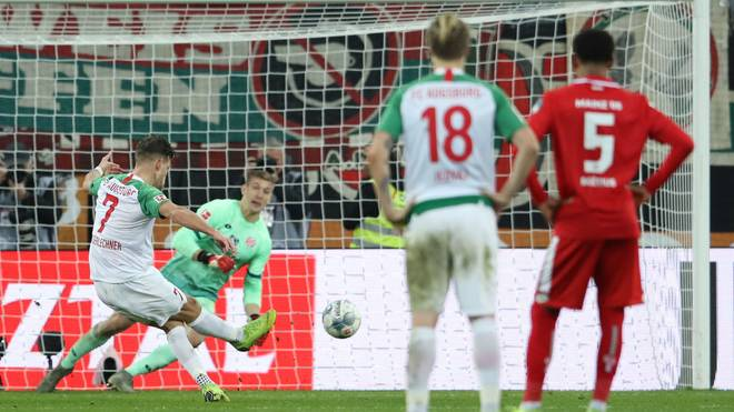 AUGSBURG, GERMANY - DECEMBER 07: Florian Niederlechner of FC Augsburg scores his team's second goal from the penalty spot during the Bundesliga match between FC Augsburg and 1. FSV Mainz 05 at WWK-Arena on December 07, 2019 in Augsburg, Germany. (Photo by Alexander Hassenstein/Bongarts/Getty Images)