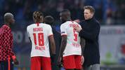 Leipzig's German head coach Julian Nagelsmann (R) congrats French defender Dayot Upamecano (2nd R) and French midfielder Christopher Nkunku (3rd R) after the UEFA Champions League Group G football match between RB Leipzig and SL Benfica on November 27, 2019, in Leipzig, eastern Germany. (Photo by Ronny Hartmann / AFP) (Photo by RONNY HARTMANN/AFP via Getty Images)