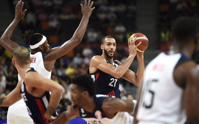 France's Rudy Gobert holds the ball as Myles Turner (L) of the US tries to block during the Basketball World Cup quarter-final game between US and France in Dongguan on September 11, 2019. (Photo by Ye Aung Thu / AFP)        (Photo credit should read YE AUNG THU/AFP/Getty Images)