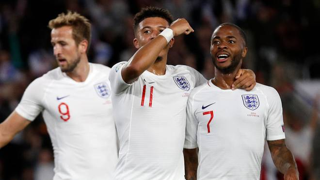 England's midfielder Jadon Sancho (C) celebrates with England's midfielder Raheem Sterling (R) after scoring his second, and the team's fifth goal during the UEFA Euro 2020 qualifying Group A football match between England and Kosovo at St Mary's stadium in Southampton, southern England on September 10, 2019. (Photo by Adrian DENNIS / AFP) / NOT FOR MARKETING OR ADVERTISING USE / RESTRICTED TO EDITORIAL USE        (Photo credit should read ADRIAN DENNIS/AFP/Getty Images)