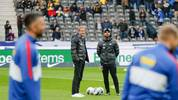 Hertha Berlin's German head coach Jurgen Klinsmann (L) and Hertha Berlin's assistant coach Alexander Nouri stand on the field prior the German first division Bundesliga football match Hertha Berlin v Borussia Dortmund in Berlin, Germany on November 30, 2019. (Photo by Odd ANDERSEN / AFP) / RESTRICTIONS: DFL REGULATIONS PROHIBIT ANY USE OF PHOTOGRAPHS AS IMAGE SEQUENCES AND/OR QUASI-VIDEO (Photo by ODD ANDERSEN/AFP via Getty Images)