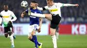 GELSENKIRCHEN, GERMANY - JANUARY 17: Oscar Wendt of Borussia Monchengladbach and Daniel Caligiuri of FC Schalke 04  during the Bundesliga match between FC Schalke 04 and Borussia Moenchengladbach at Veltins-Arena on January 17, 2020 in Gelsenkirchen, Germany. (Photo by Lars Baron/Bongarts/Getty Images)