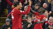 Liverpool's Senegalese striker Sadio Mane (R) celebrates with Liverpool's Dutch defender Virgil van Dijk (L) after scoring their third goal during the English Premier League football match between Liverpool and Manchester City at Anfield in Liverpool, north west England on November 10, 2019. (Photo by Paul ELLIS / AFP) / RESTRICTED TO EDITORIAL USE. No use with unauthorized audio, video, data, fixture lists, club/league logos or 'live' services. Online in-match use limited to 120 images. An additional 40 images may be used in extra time. No video emulation. Social media in-match use limited to 120 images. An additional 40 images may be used in extra time. No use in betting publications, games or single club/league/player publications. /  (Photo by PAUL ELLIS/AFP via Getty Images)