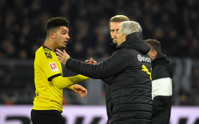 Dortmund's English forward Jadon Sancho and Dortmund's Swiss coach Lucien Favre (R) speak on the sideline during the German first division Bundesliga football match BVB Borussia Dortmund vs Eintracht Frankfurt, in Dortmund, western Germany on February 14, 2020. (Photo by INA FASSBENDER / AFP) / RESTRICTIONS: DFL REGULATIONS PROHIBIT ANY USE OF PHOTOGRAPHS AS IMAGE SEQUENCES AND/OR QUASI-VIDEO (Photo by INA FASSBENDER/AFP via Getty Images)