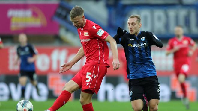 PADERBORN, GERMANY - DECEMBER 14: Marvin Friedrich of 1. FC Union Berlin shoots while challenged by Ben Zolinski of SC Paderborn 07 during the Bundesliga match between SC Paderborn 07 and 1. FC Union Berlin at Benteler Arena on December 14, 2019 in Paderborn, Germany. (Photo by Christof Koepsel/Bongarts/Getty Images)