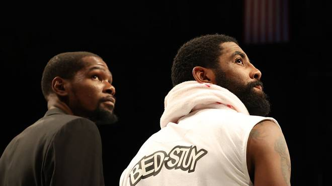 NEW YORK, NEW YORK - JANUARY 18:  Kevin Durant #7 and Kyrie Irving #11 of the Brooklyn Nets look on during their game against the Milwaukee Bucks at Barclays Center on January 18, 2020 in New York City.   NOTE TO USER: User expressly acknowledges and agrees that, by downloading and/or using this photograph, user is consenting to the terms and conditions of the Getty Images License Agreement.  (Photo by Al Bello/Getty Images)
