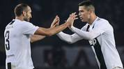 Juventus' Portuguese forward Cristiano Ronaldo (R) celebrates with Juventus' Italian defender Giorgio Chiellini after opening the scoring during the Italian Serie A football match Torino vs Juventus on December 15, 2018 at the Olympic stadium in Turin. (Photo by Marco BERTORELLO / AFP)        (Photo credit should read MARCO BERTORELLO/AFP via Getty Images)