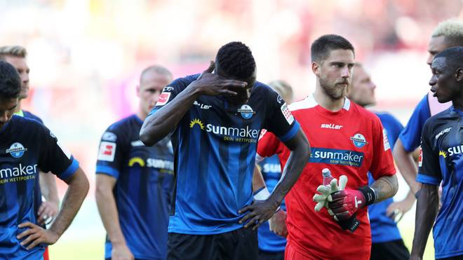PADERBORN, GERMANY - AUGUST 24: SC Paderborn 07 side cuts a dejected figures after losing during the Bundesliga match between SC Paderborn 07 and Sport-Club Freiburg at Benteler Arena on August 24, 2019 in Paderborn, Germany. (Photo by Christof Koepsel/Bongarts/Getty Images)