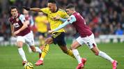 BURNLEY, ENGLAND - FEBRUARY 02: Pierre-Emerick Aubameyang of Arsenal is challenged by Matthew Lowton of Burnley during the Premier League match between Burnley FC and Arsenal FC at Turf Moor on February 02, 2020 in Burnley, United Kingdom. (Photo by Gareth Copley/Getty Images)