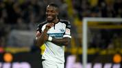 Paderborn's German forward Streli Mamba celebrates after scoring during the German first division Bundesliga football match Borussia Dortmund v SC Paderborn in Dortmund, western Germany, on November 22, 2019. (Photo by INA FASSBENDER / AFP) / RESTRICTIONS: DFL REGULATIONS PROHIBIT ANY USE OF PHOTOGRAPHS AS IMAGE SEQUENCES AND/OR QUASI-VIDEO (Photo by INA FASSBENDER/AFP via Getty Images)