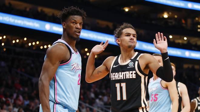 Trae Young (r.) ließ die Miami Heat um Jimmy Butler (l.) alt aussehen