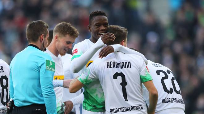 MOENCHENGLADBACH, GERMANY - NOVEMBER 10:  Patrick Herrmann of Borussia Monchengladbach (7) celebrates after scoring his team's second goal with team mate Denis Zakaria during the Bundesliga match between Borussia Moenchengladbach and SV Werder Bremen at Borussia-Park on November 10, 2019 in Moenchengladbach, Germany. (Photo by Christof Koepsel/Bongarts/Getty Images)