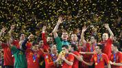 Spain's striker David Villa kisses the trophy during the award ceremony following the 2010 FIFA football World Cup between the Netherlands and Spain on July 11, 2010 at Soccer City stadium in Soweto, suburban Johannesburg. Spain won 1-0. NO PUSH TO MOBILE / MOBILE USE SOLELY WITHIN EDITORIAL ARTICLE  AFP PHOTO / THOMAS COEX (Photo credit should read THOMAS COEX/AFP via Getty Images)