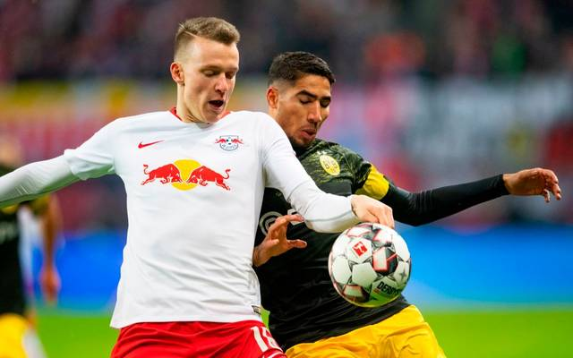 Leipzig's defender Lukas Klostermann (L) vies with Dortmund's Moroccan defender Achraf Hakimi during the German first division Bundesliga football match RB Leipzig v Borussia Dortmund in Leipzig, eastern Germany, on January 19, 2019. (Photo by ROBERT MICHAEL / AFP) / DFL REGULATIONS PROHIBIT ANY USE OF PHOTOGRAPHS AS IMAGE SEQUENCES AND/OR QUASI-VIDEO        (Photo credit should read ROBERT MICHAEL/AFP via Getty Images)