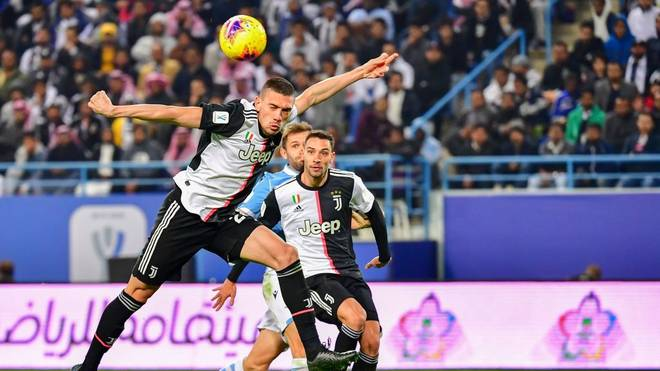Juventus' Turkish defender Merih Demiral (L) heads the ball during the Supercoppa Italiana final football match between Juventus and Lazio at the King Saud University Stadium in the Saudi capital Riyadh on December 22, 2019. (Photo by GIUSEPPE CACACE / AFP) (Photo by GIUSEPPE CACACE/AFP via Getty Images)