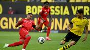 DORTMUND, GERMANY - MAY 26: Serge Gnabry of Bayern Munich is challenged by Achraf Hakimi Mouh of Borussia Dortmund during the Bundesliga match between Borussia Dortmund and FC Bayern Muenchen at Signal Iduna Park on May 26, 2020 in Dortmund, Germany. (Photo by Federico Gambarini/Pool via Getty Images)