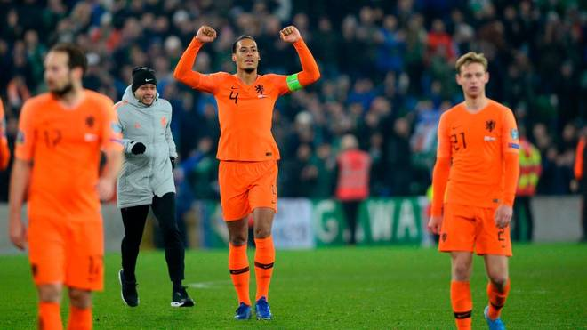 Netherlands' defender Virgil van Dijk (C) celebrates their qualification for the finals on the pitch after the Euro 2020 qualification football match between Northern Ireland and Netherlands at Windsor Park in Belfast on November 16, 2019. (Photo by Mark MARLOW / AFP) (Photo by MARK MARLOW/AFP via Getty Images)