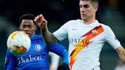 Ghent's Canadian forward Jonathan David (L)  is challenged by AS Roma's Italian defender Gianluca Mancini during the UEFA Europa League round of 32 second leg football match between KAA Gent and AS Roma,  on February 27, 2020 at the KAA Gent Stadium, in Gand, Belgium. (Photo by kenzo tribouillard / AFP) (Photo by KENZO TRIBOUILLARD/AFP via Getty Images)