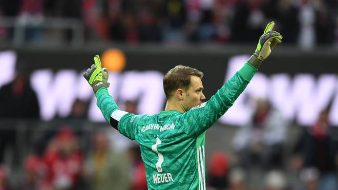 COLOGNE, GERMANY - FEBRUARY 16: Manuel Neuer of FC Bayern Muenchen celebrates at the final whistle during the Bundesliga match between 1. FC Koeln and FC Bayern Muenchen at RheinEnergieStadion on February 16, 2020 in Cologne, Germany. (Photo by Jörg Schüler/Bongarts/Getty Images)