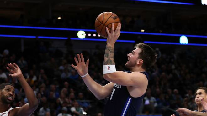 DALLAS, TEXAS - NOVEMBER 22:  Luka Doncic #77 of the Dallas Mavericks takes a shot against the Cleveland Cavaliers in the second half at American Airlines Center on November 22, 2019 in Dallas, Texas.  NOTE TO USER: User expressly acknowledges and agrees that, by downloading and or using this photograph, User is consenting to the terms and conditions of the Getty Images License Agreement.  (Photo by Ronald Martinez/Getty Images)