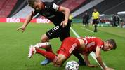 BERLIN, GERMANY - JULY 04: Bayer Leverkusen's Lars Bender battles for possession with Bayern Munich's Thomas Muller during the DFB Cup final match between Bayer 04 Leverkusen and FC Bayern Muenchen at Olympiastadion on July 4, 2020 in Berlin, Germany. (Photo by Annegret Hilse/Pool via Getty Images)