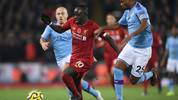 LIVERPOOL, ENGLAND - NOVEMBER 10: Sadio Mane of Liverpool battles for possession with Fernandinho of Manchester City during the Premier League match between Liverpool FC and Manchester City at Anfield on November 10, 2019 in Liverpool, United Kingdom. (Photo by Laurence Griffiths/Getty Images)