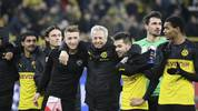 Dortmund's Swiss coach Lucien Favre celebrates with the team after the UEFA Champions League Group F football match between Borussia Dortmund and SK Slavia Prague on December 10, 2019 in Dortmund, western Germany. (Photo by Ina Fassbender / AFP) (Photo by INA FASSBENDER/AFP via Getty Images)
