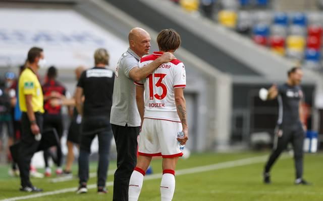 Uwe Rösler (l.) und Adam Bodzek wollen mit Fortuna Düsseldorf Platz 16 verteidigen