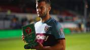 NEWPORT, WALES - AUGUST 27: Jack Wilshere of West Ham United with his player of the match award after the Carabao Cup Second Round match between Newport County and West Ham United at Rodney Parade on August 27, 2019 in Newport, Wales. (Photo by Catherine Ivill/Getty Images)