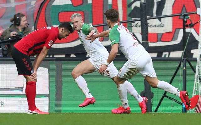 AUGSBURG, GERMANY - FEBRUARY 15: Philipp Max (C) of FC Augsburg celebrates his first goal together with teammate Florian Niederlechner (R) during the Bundesliga match between FC Augsburg and Sport-Club Freiburg at WWK-Arena on February 15, 2020 in Augsburg, Germany. (Photo by Alexandra Beier/Bongarts/Getty Images)