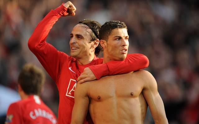 Dimitar Berbatov und Cristiano Ronaldo jubeln über den Sieg gegen Tottenham