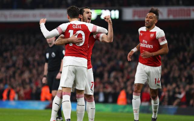 LONDON, ENGLAND - FEBRUARY 27: Henrikh Mkhitaryan of Arsenal celebrates after scoring his team's second goal with Mesut Ozil of Arsenal during the Premier League match between Arsenal FC and AFC Bournemouth at Emirates Stadium on February 27, 2019 in London, United Kingdom. (Photo by Catherine Ivill/Getty Images)