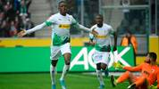 Moenchengladbach's Swiss midfielder Denis Zakaria (L) celebrates after scoring the 1-0 goal during the German first division Bundesliga football match Borussia Moenchengladbach vs FC Augsburg in Moenchengladbach, western Germany, on October 6, 2019. (Photo by Ina FASSBENDER / AFP) / DFL REGULATIONS PROHIBIT ANY USE OF PHOTOGRAPHS AS IMAGE SEQUENCES AND/OR QUASI-VIDEO (Photo by INA FASSBENDER/AFP via Getty Images)