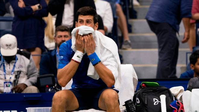 Novak Djokovic of Serbia wipes his face with his towel while playing Stan Wawrinka of Switzerland during their Round Four Men's Singles match at the 2019 US Open at the USTA Billie Jean King National Tennis Center in New York on September 1, 2019. (Photo by Don Emmert / AFP)        (Photo credit should read DON EMMERT/AFP/Getty Images)
